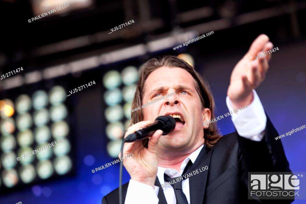 Stock Photo: Roermond, Netherlands, Hans Teeuwen is performing and singing at Solar event.