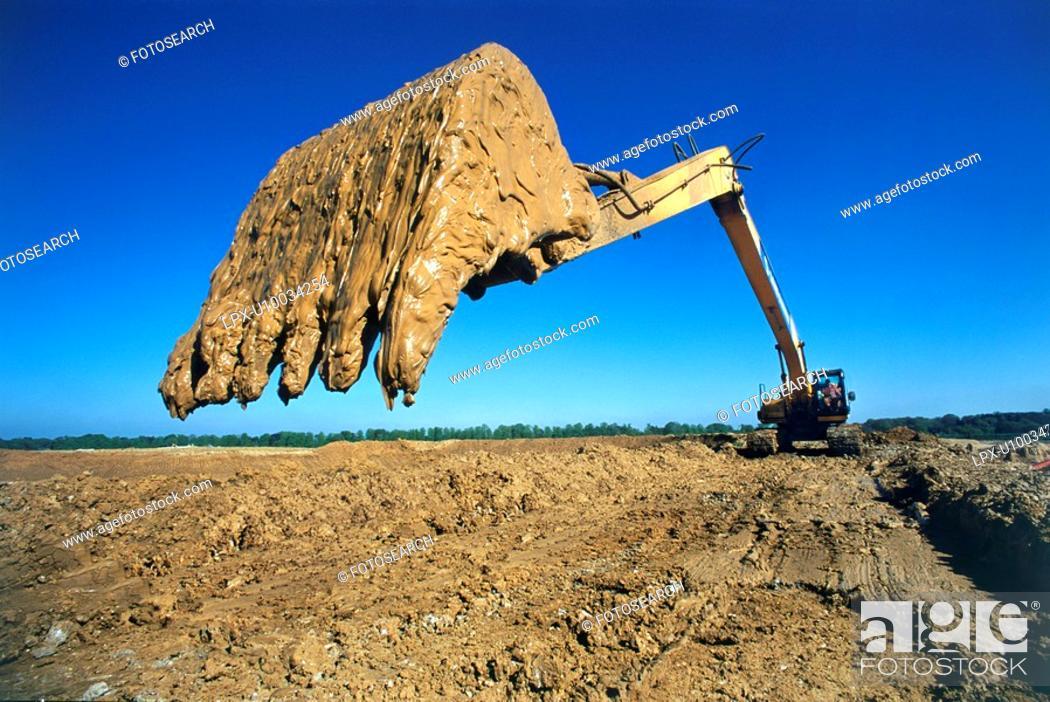 Stock Photo: Mud on an excavator bucket.