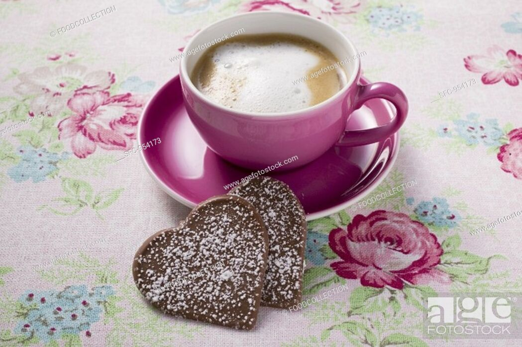 Stock Photo: Cup of cappuccino with two chocolate hearts.