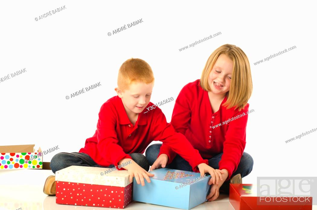 Stock Photo: Children almost fighting over Christmas gifts.