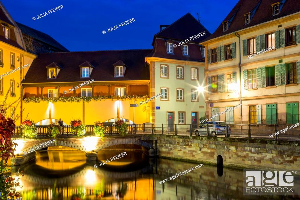 Stock Photo: Colorful canal night scene at twilight, La Petite France, Strasbourg, Alsace, France with reflections on the tranquil water at this historic Unesco World.