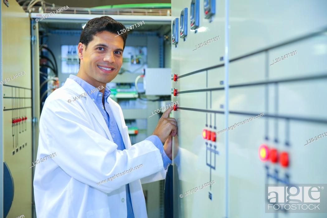 Stock Photo: Researcher. Low Voltage Micro Network. Testing and Certificates Services for Smart Grids and Smart meters. Certification of Power Electronics Equipment.