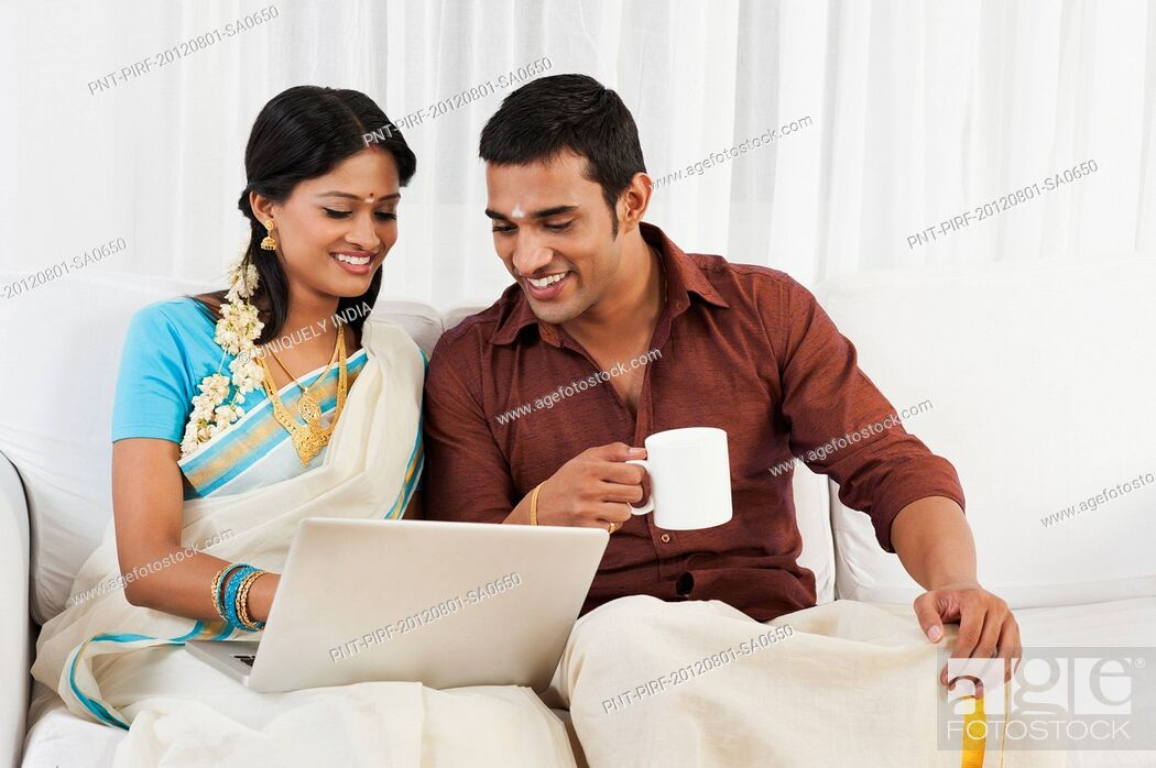 Stock Photo: South Indian couple using a laptop.