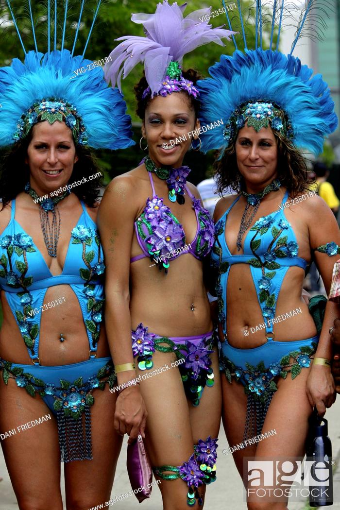 Women wearing elaborate costumes at The Caribana Festival and Parade