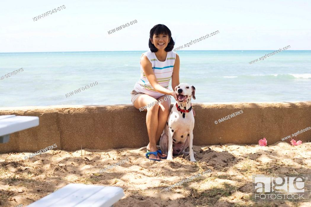 Stock Photo: View of a woman sitting with dog.