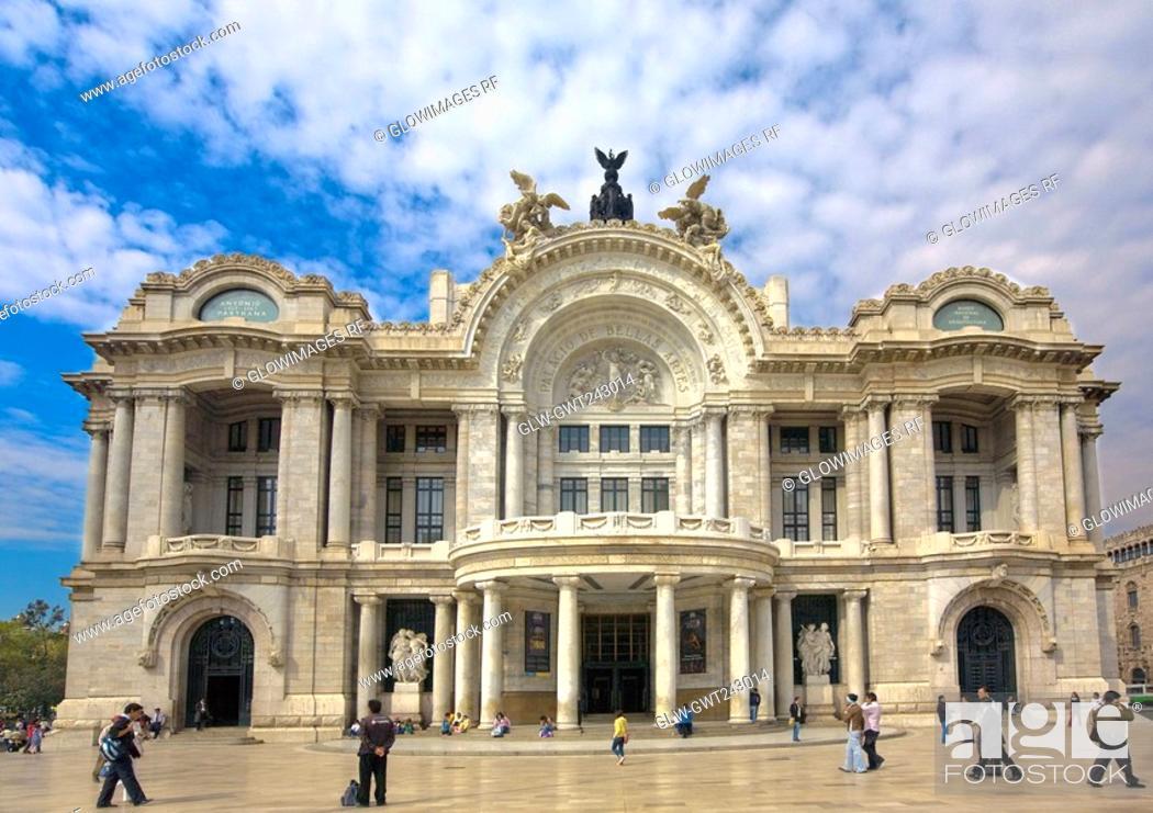 Stock Photo: Tourists in front of a palace, Palacio De Bellas Artes, Mexico City, Mexico.