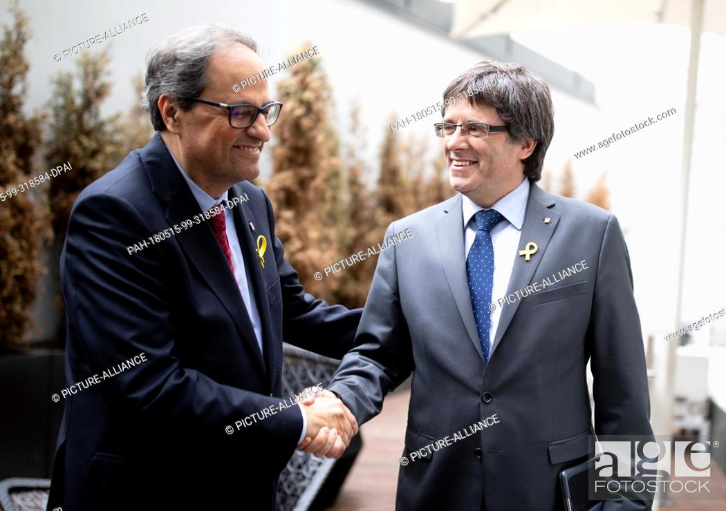 Stock Photo: 15 May 2018, Berlin, Germany: Catalan regional president Quim Torra (l) and his predecessor Carles Puigdemont shake hands before a press conference.