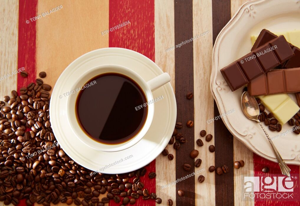 Stock Photo: Coffee cup breakfast with chocolate and coffee beans on red brown wooden table.