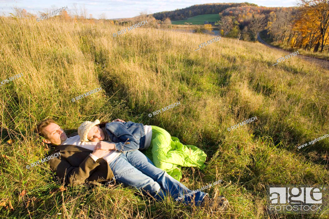 Stock Photo: Couple lying in field in the sunshine.