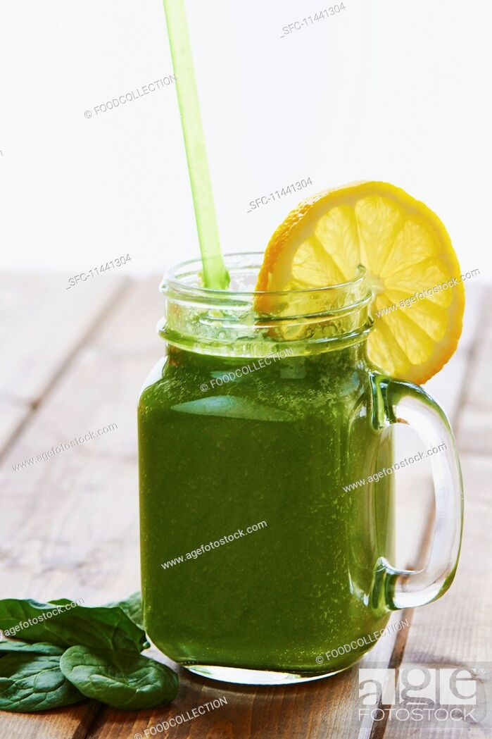 Stock Photo: A green smoothie with a slice of lemon.