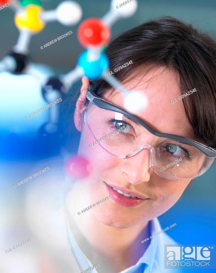Stock Photo: Scientist analysing molecular model in laboratory.