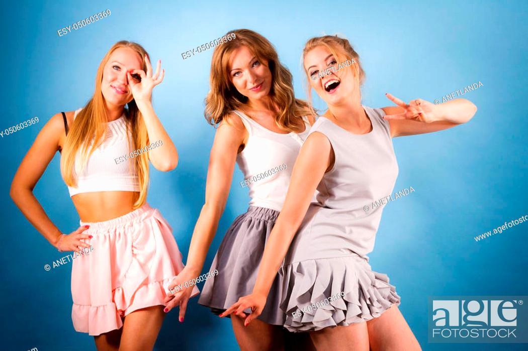 Stock Photo: Happy positive female friends having fun enjoying their feminine leisure time. Friendship, elegant fashion concept.