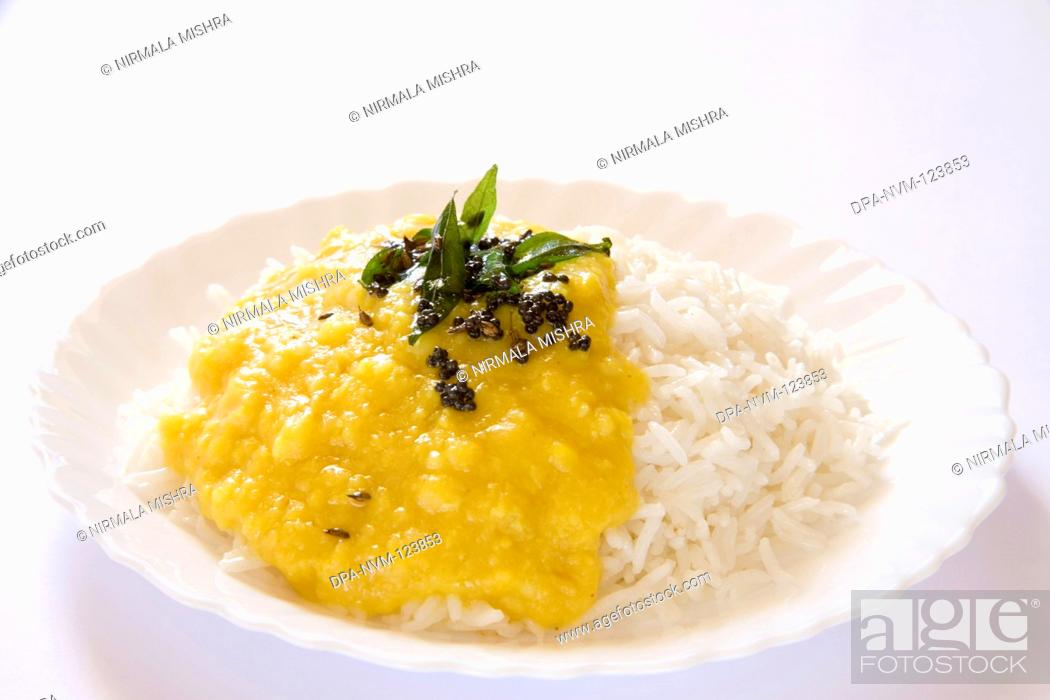 Stock Photo: Indian cuisine boil basmati rice bhath chaval oryza sativa and fry or tadka moong dal mung beans phaseolus aureus , India.