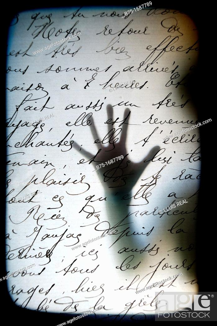 Stock Photo: Silhouetted hand on handwritten text.