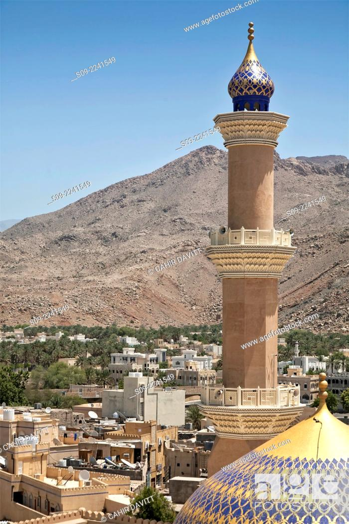 Stock Photo: View from Nizwa Fort of the minaret of the As Sultan Qaboos Mosque with the Hajar Mountains in the background, Al Jinah, Nizwa, Ad Dakhiliyah Governorate, Oman.