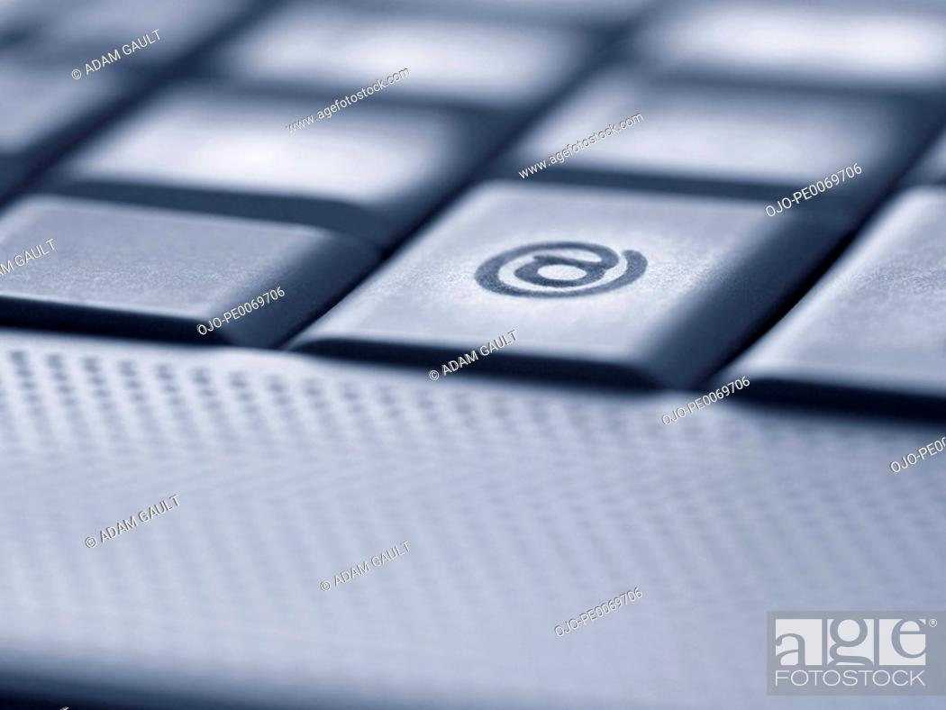 Close Up Of The At Symbol Key On Computer Keyboard Stock Photo