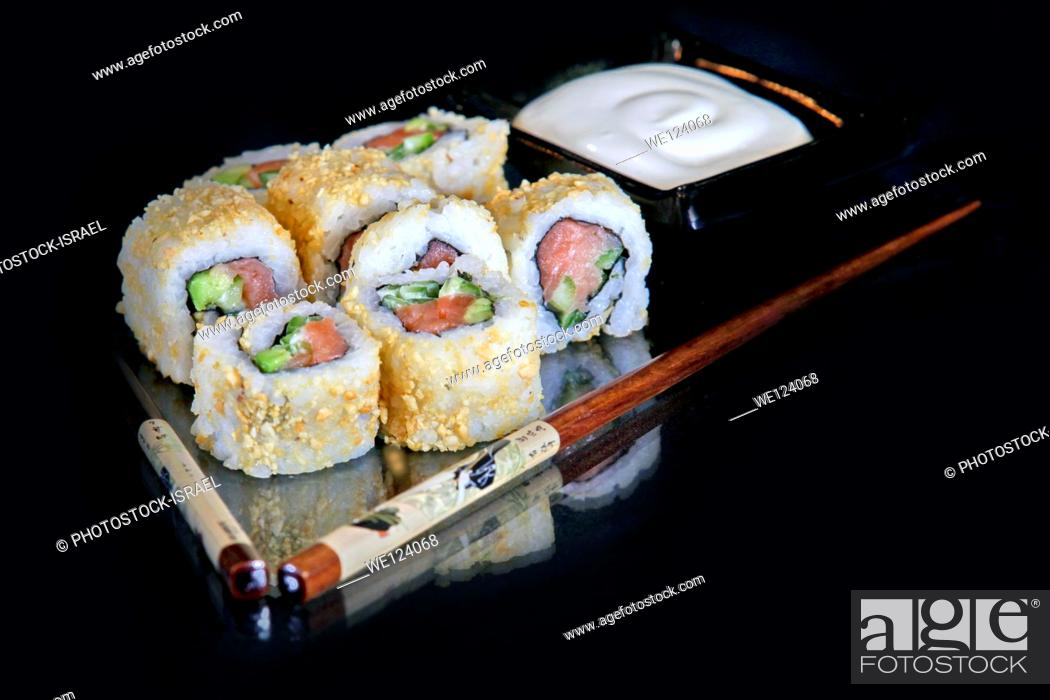 Stock Photo: An assortment of insideout Sushi to be served.