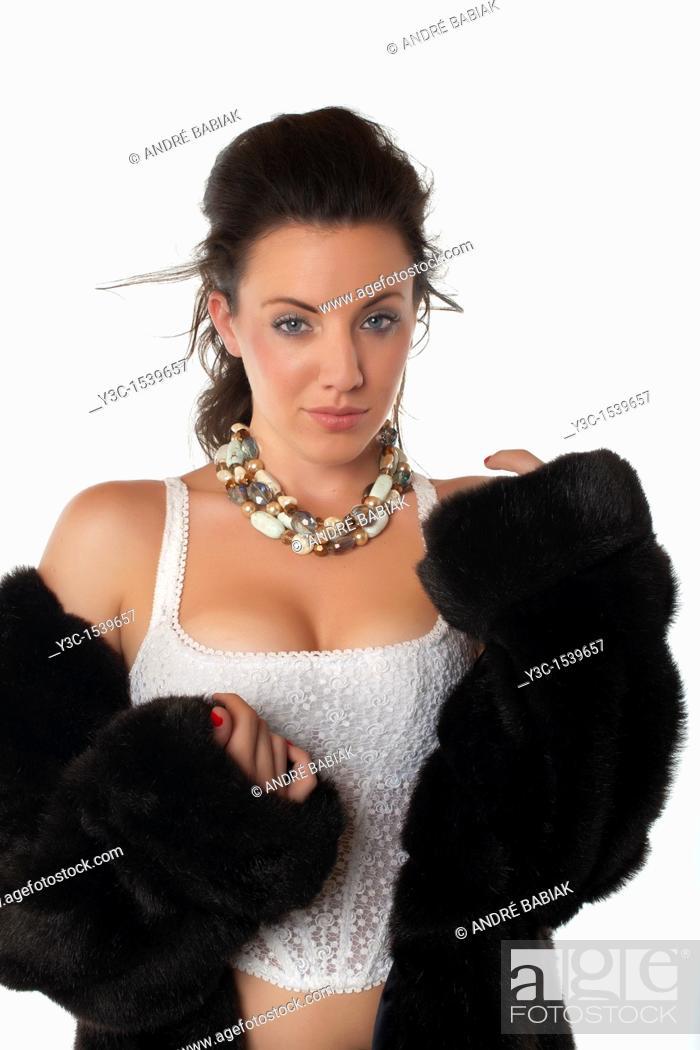 Stock Photo: Beautiful woman in mink coat.