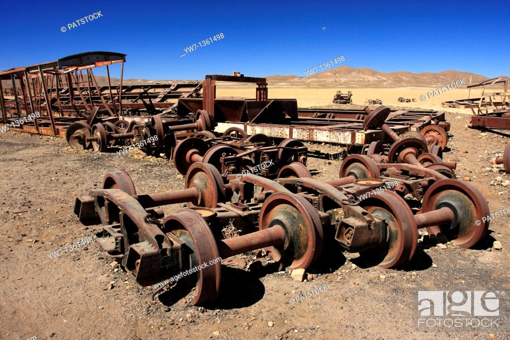 Stock Photo: Wheels and axles of wrecked old trains in the vicinity of Uyuni, Bolivia.