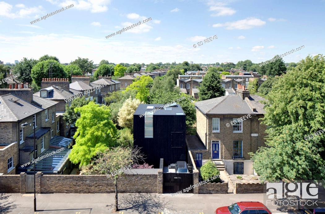 Stock Photo: A three storey house in conservation area of De Beauvoir town in Hackney. The site has been excavated to basement level creating.