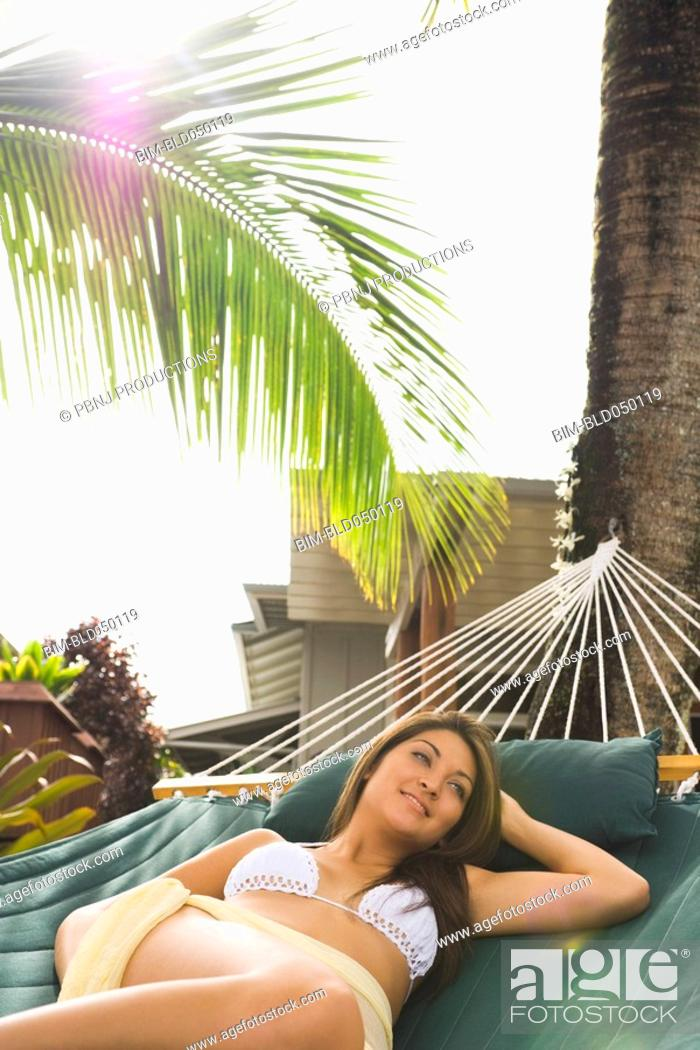 Stock Photo: Asian woman laying in hammock.