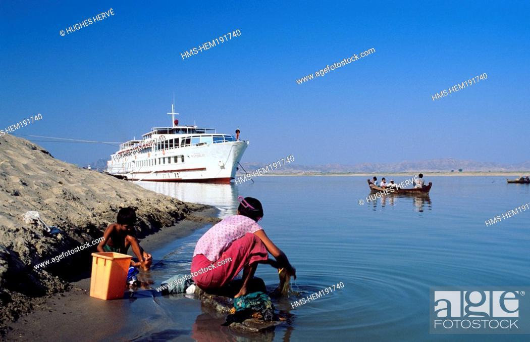 Stock Photo: Myanmar Burma, washing on Irrawaddy river banks near Road to Mandalay cruise ship.