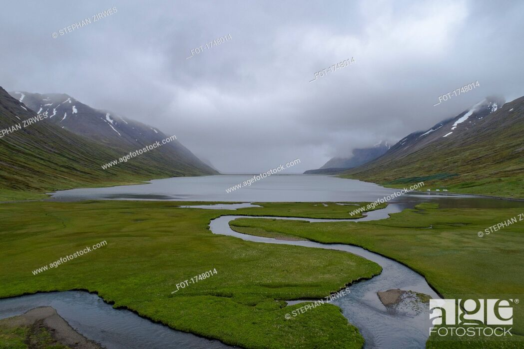Stock Photo: Scenic view of fjord amidst mountains against cloudy sky, Iceland.