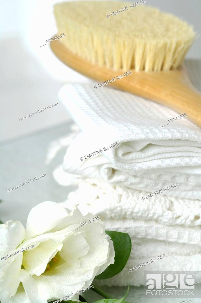 Stock Photo: Piqué towels and a massage brush decorated with lisianthus flowers.