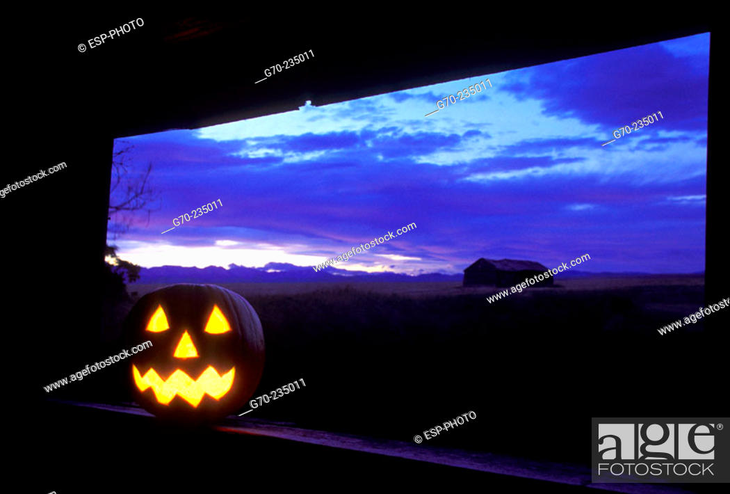 Stock Photo: Iluminated Halloween Jack-O-Lantern in abandoned farm house.