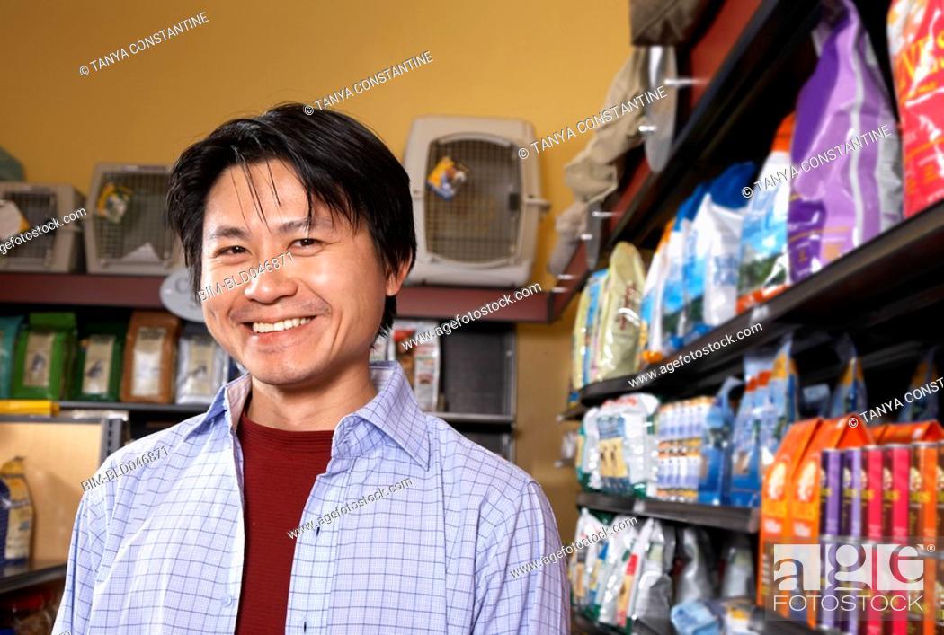 Stock Photo: Asian man in pet store.
