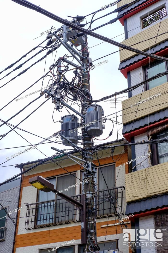 Stock Photo: Typical orderly power and utility lines in Tokyo, Japan.