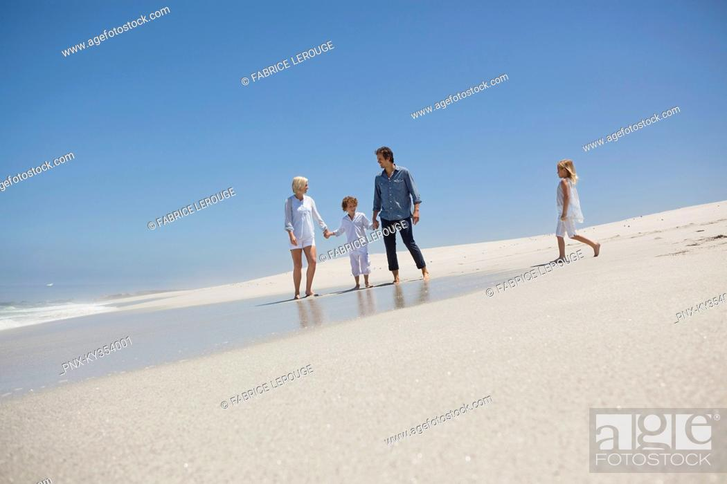 Stock Photo: Family enjoying on the beach.