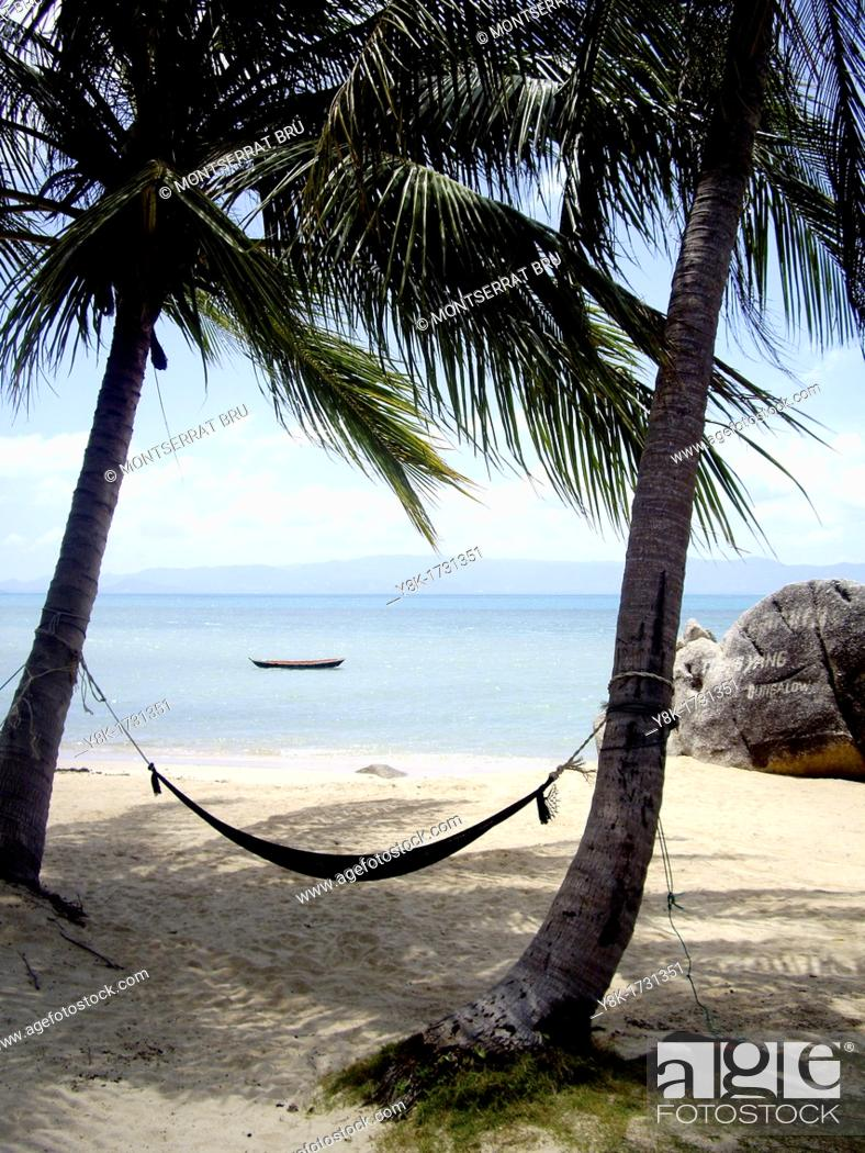 Stock Photo: Tropical white sand beach with hammock tied to two palmtrees near Ban Tai, Koh Phangan, Thailand.