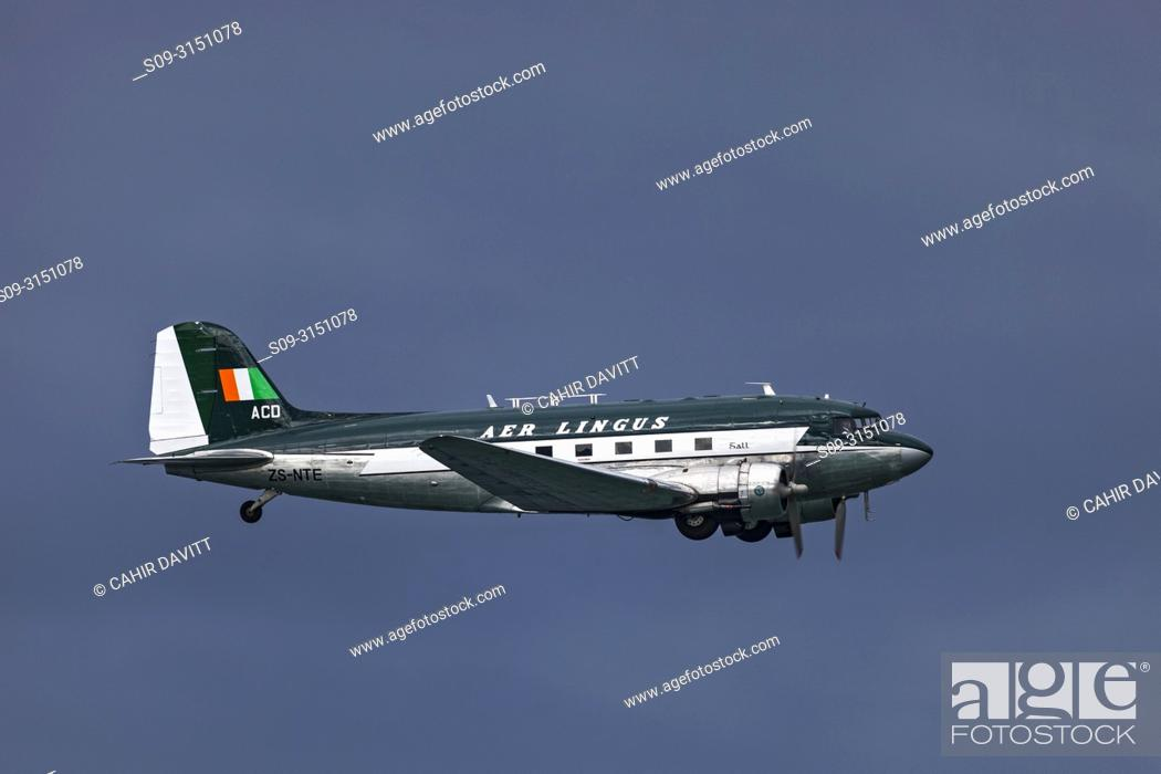 Stock Photo: The Irish Historical Flight Douglas DC 3 in vintage Aer Lingus livery flying over Bray, Co. Wicklow, Ireland.