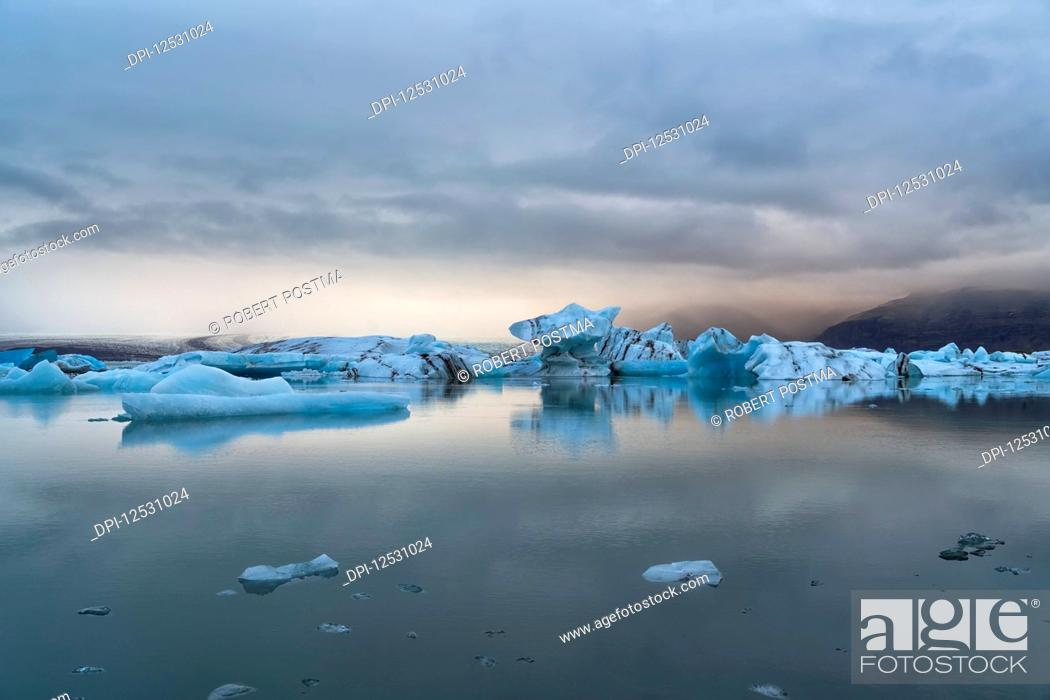Stock Photo: Jokulsarlon, a large lagoon filled with icebergs along the Southern coast of Iceland; Iceland.