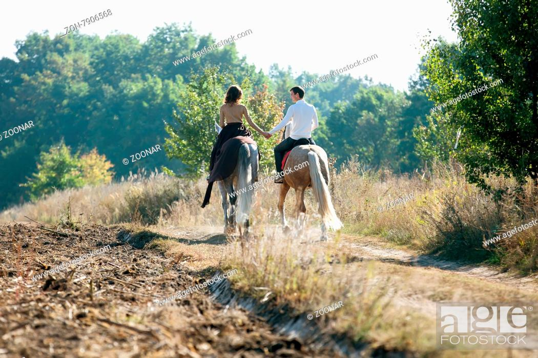 Young Couple In Love Riding A Horse Walking On The Background Of Autumn Nature In A Beautiful Field Stock Photo Picture And Rights Managed Image Pic Zon 7906568 Agefotostock