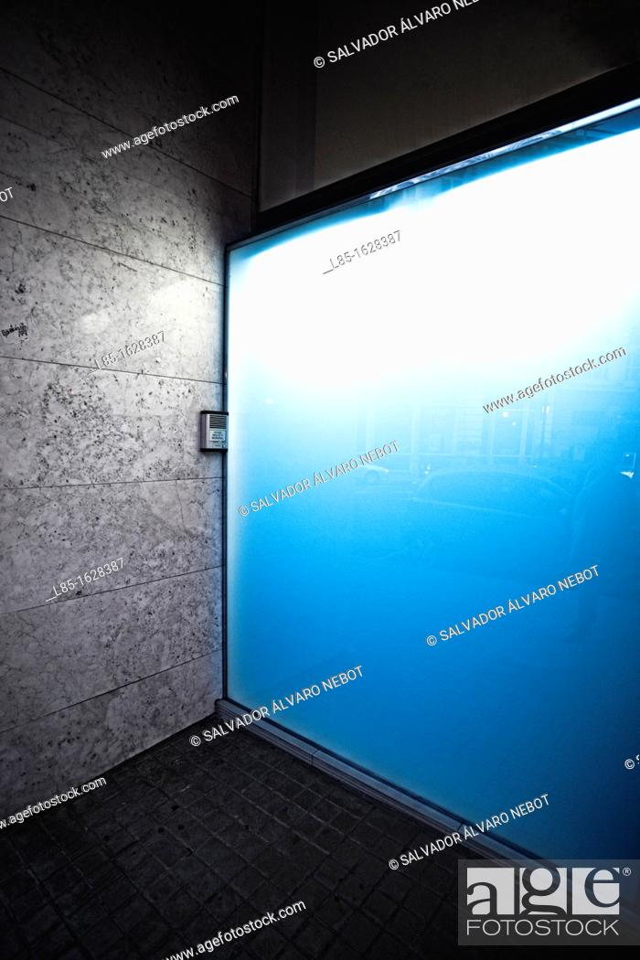 Stock Photo: Housing Portal illuminated in blue.