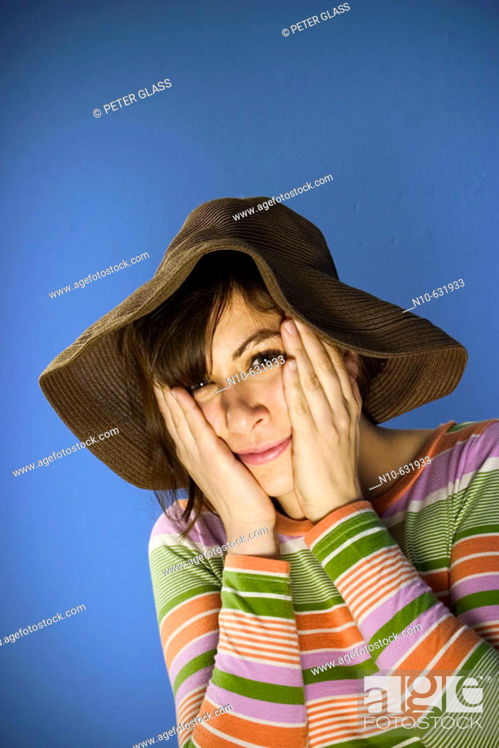 Stock Photo: Young woman wearing a hat.