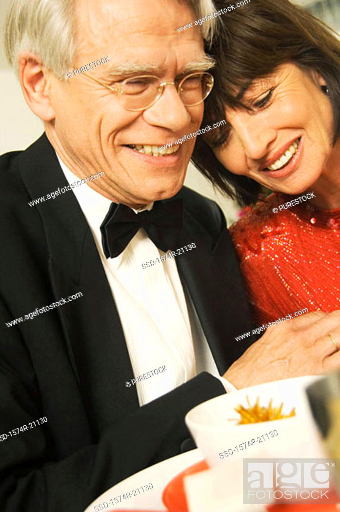 Stock Photo: Close-up of a mature couple smiling.
