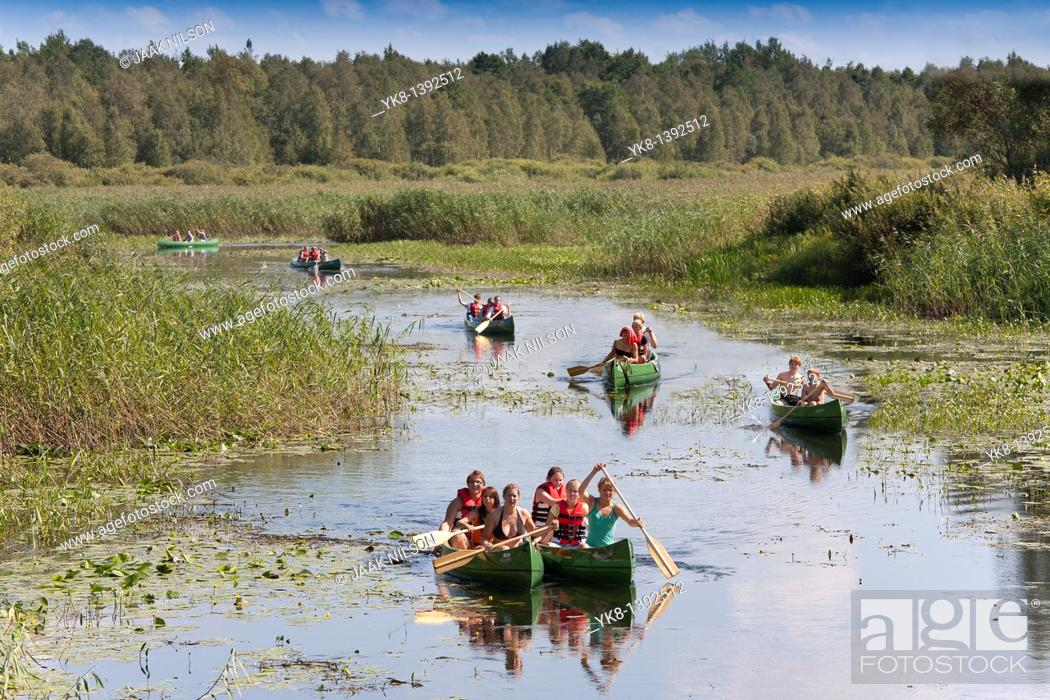 Stock Photo: Canoes on Elva River in Estonia.