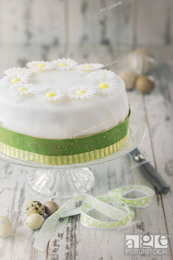 Stock Photo: Easter cake with white icing flowers.