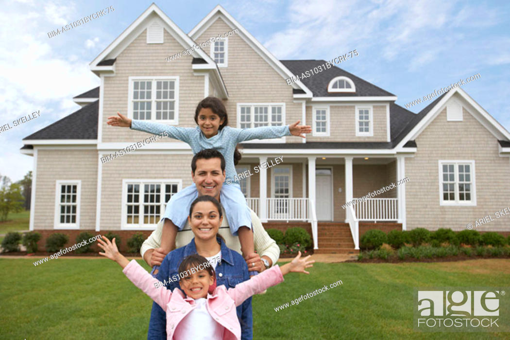 Stock Photo: Family in front of house.