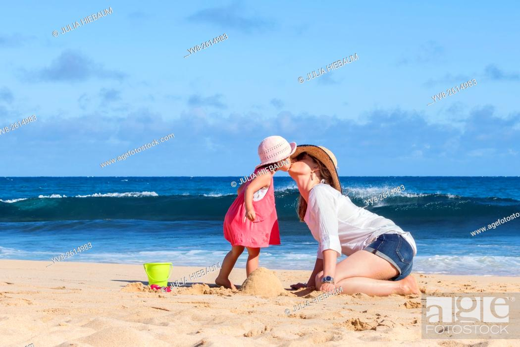Stock Photo: Mother and daughter kissing on the beach, Kauai island.