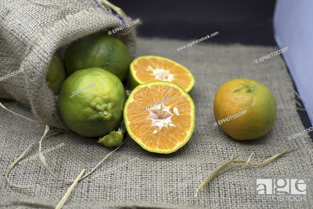 Stock Photo: Green orange in jute bag.