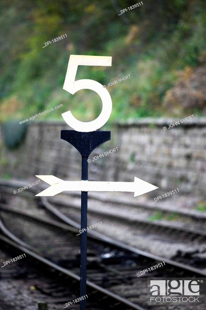 Stock Photo: Directions at a railroad crossing.