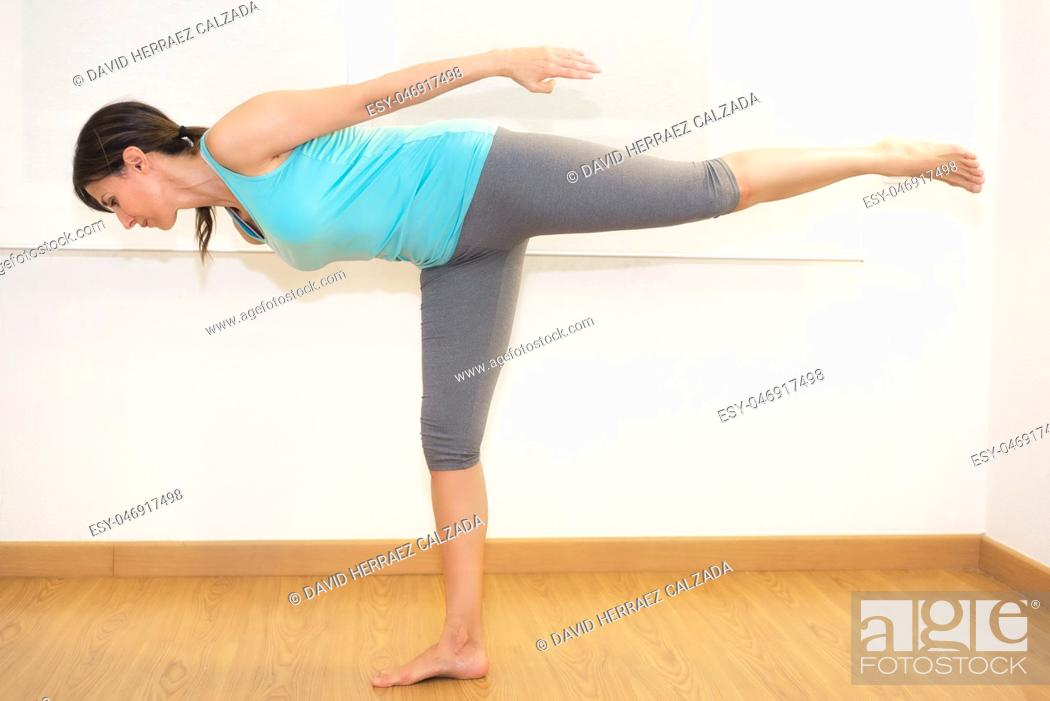 Stock Photo: Young woman practicing Yoga indoors. Healthy lifestyle.