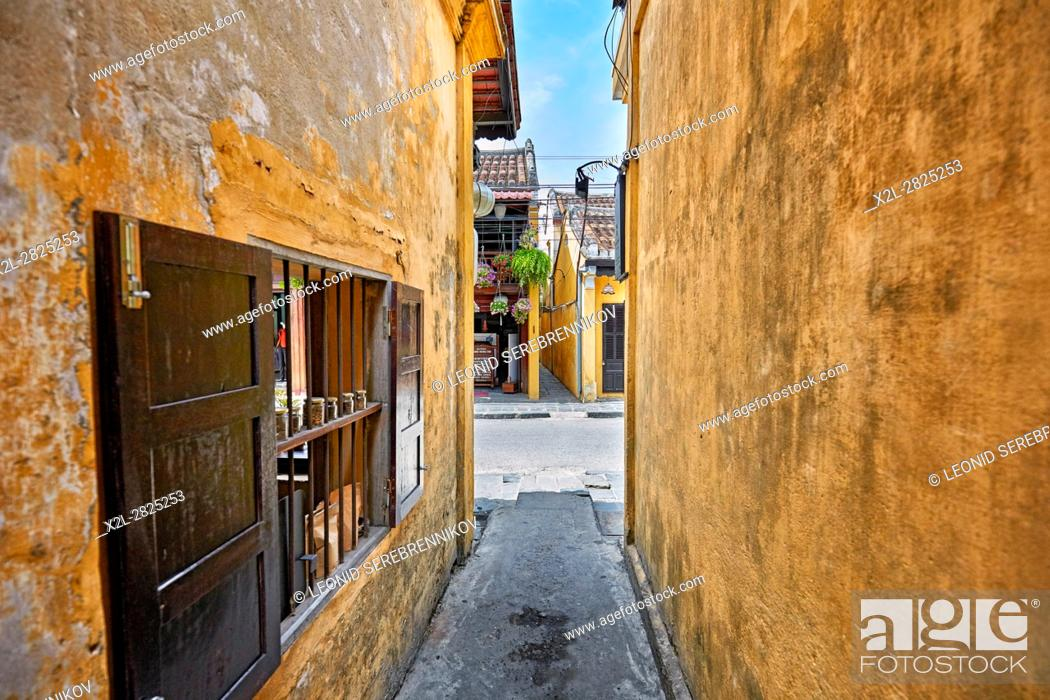 Stock Photo: Narrow alley in Hoi An Ancient Town. Quang Nam Province, Vietnam.