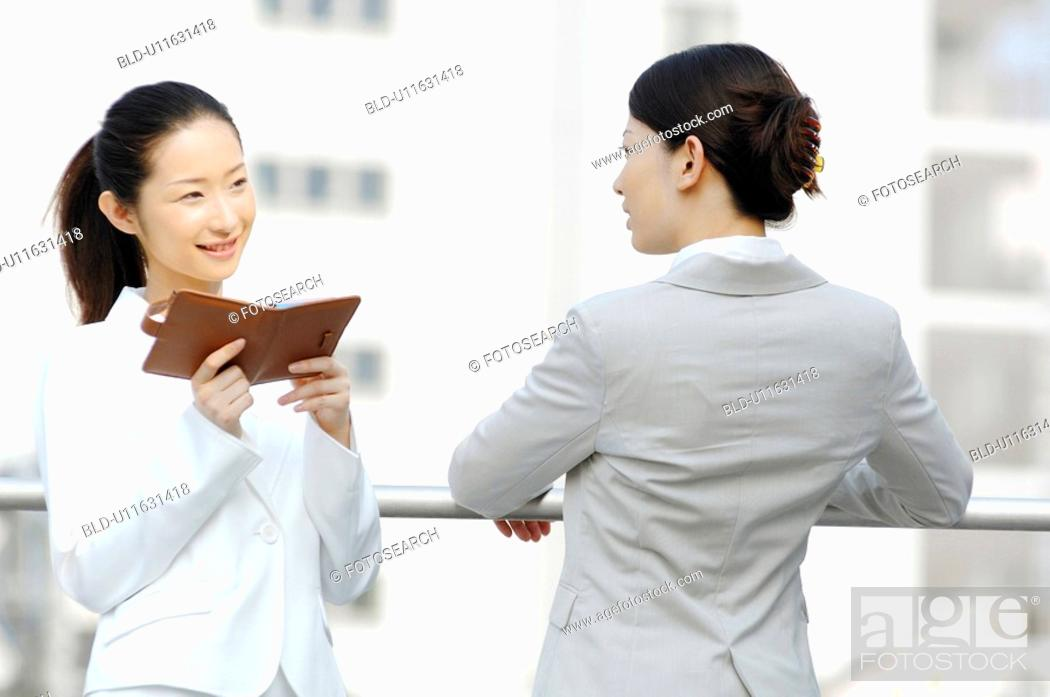 Stock Photo: Business ladies who rests at the rooftop.