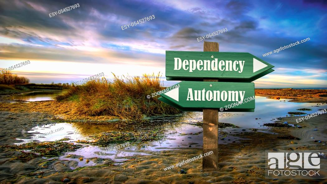 Stock Photo: Street Sign the Direction Way to Autonomy versus Dependency.