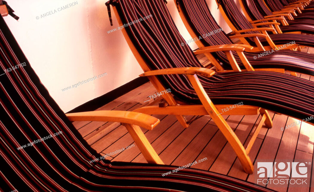 Stock Photo: row of deck chairs on cruise ship.